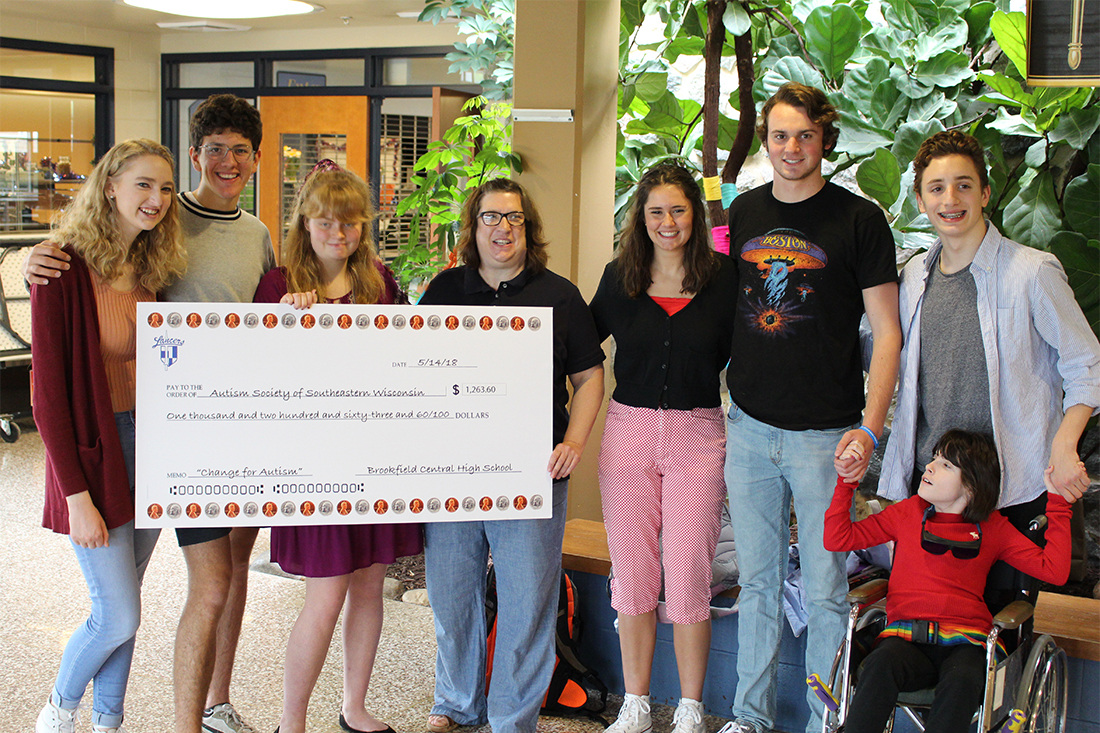 Students present Autism Society with check