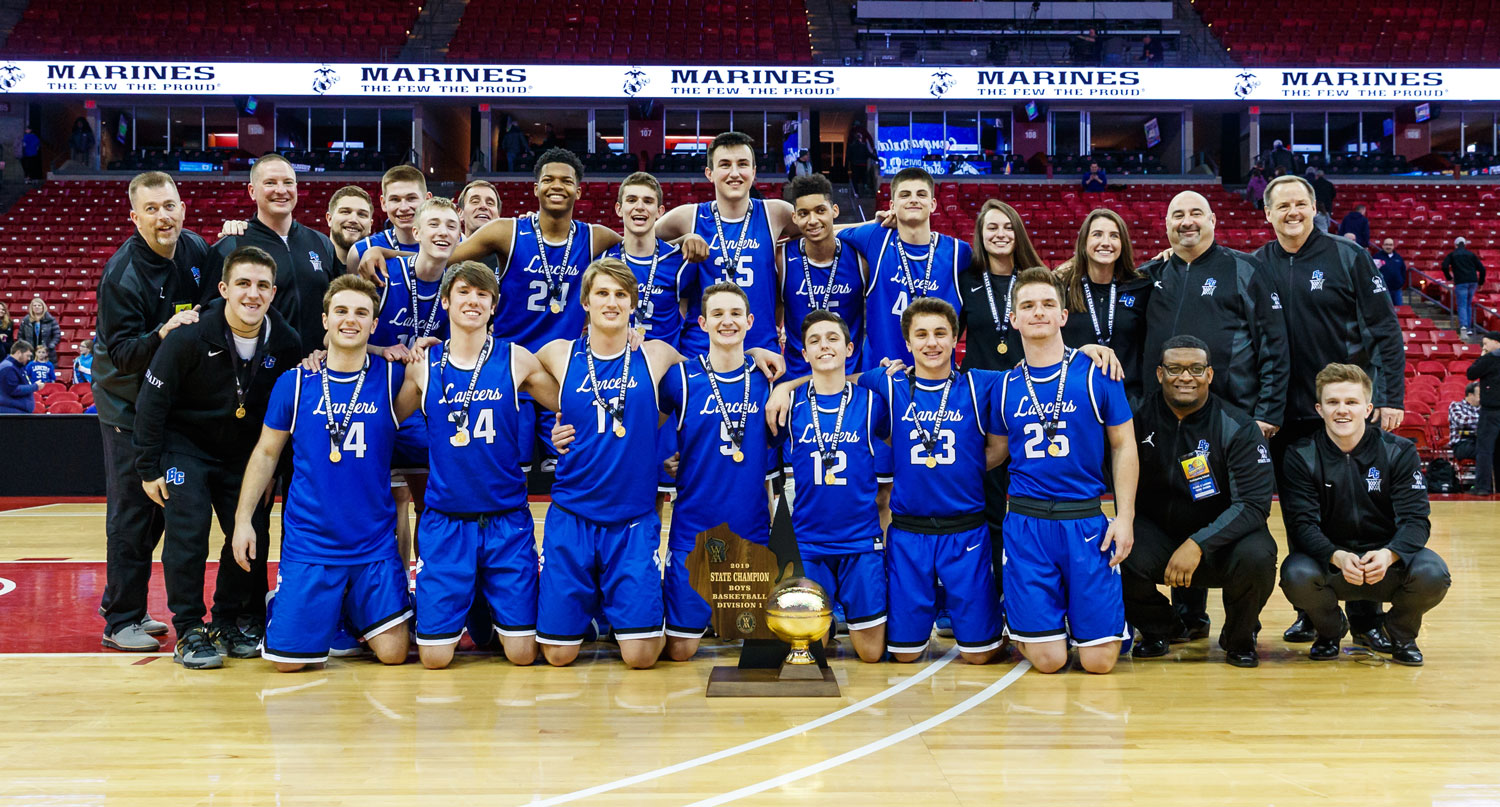 BCHS Boys Basketball team with trophy