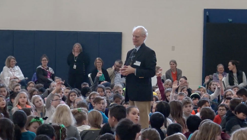 Andrew Clements speaking to students