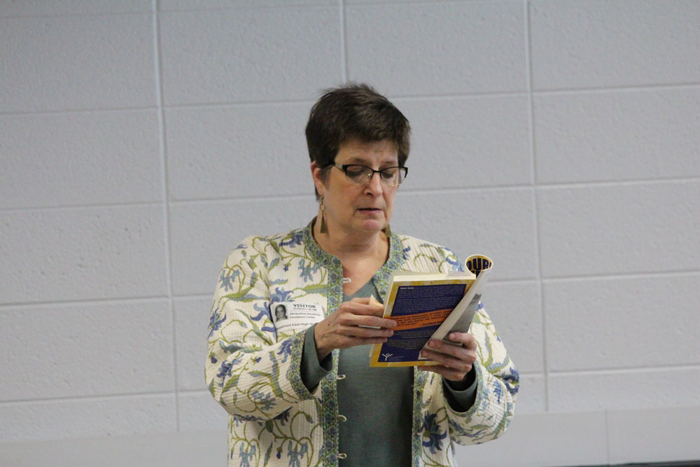 Jacqueline Houtman reading her book to students
