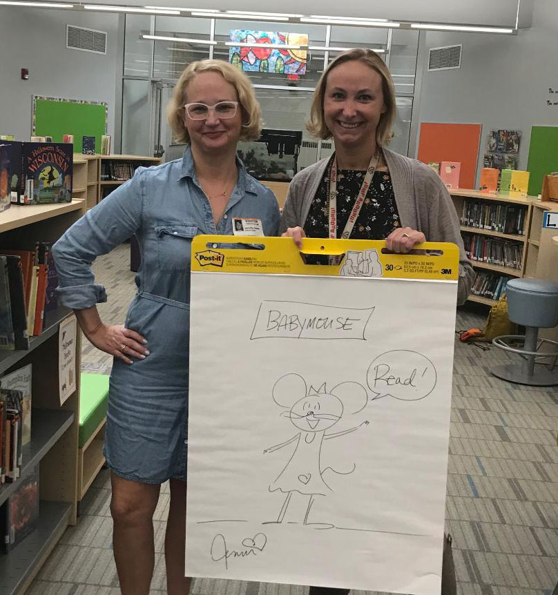 Jennifer Holm and staff member with drawing